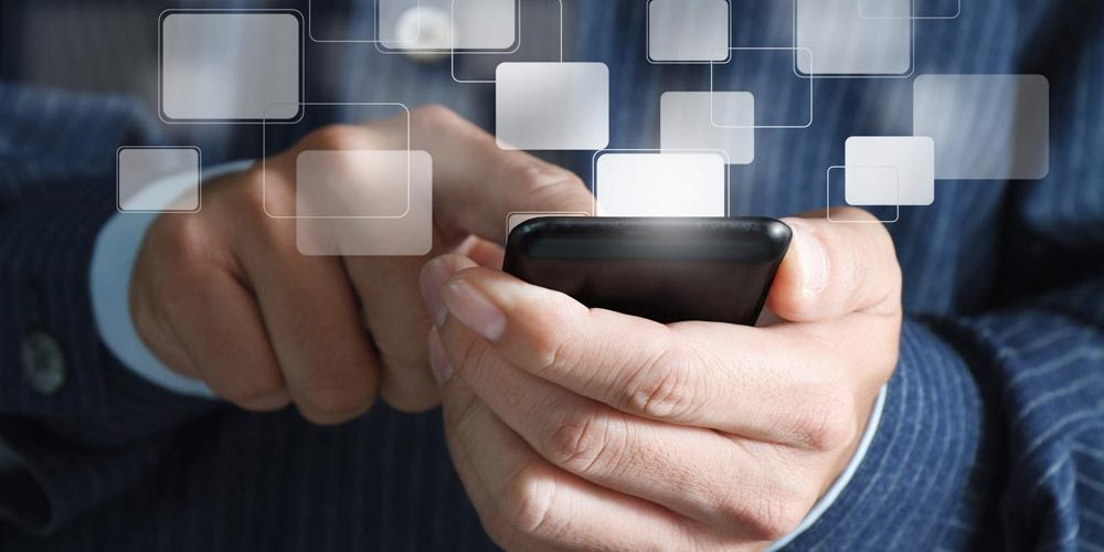 photodune-792391-close-up-of-business-hand-hold-touch-screen-mobile-phone-and-buttons-m